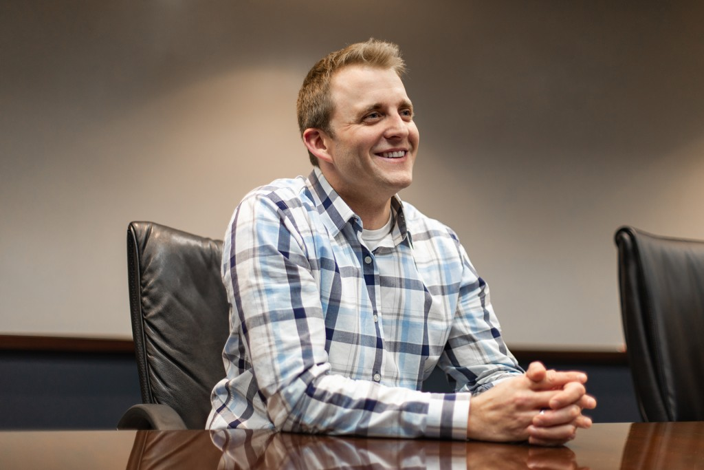 Photo of smiling man at a desk