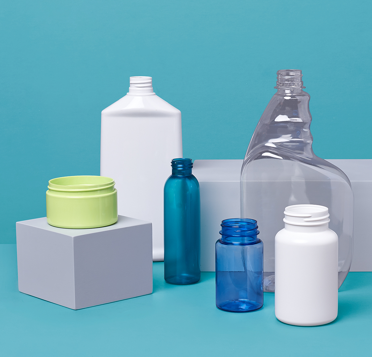 Photo of various plastic bottles on blue background